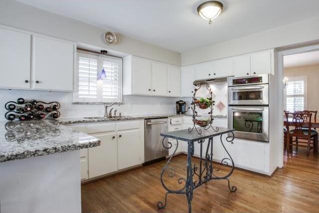Sold Property | 7048 Irongate Lane Dallas, Texas 75214 7