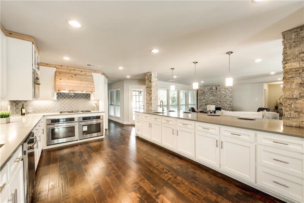 Housed Real Estate + Relocation  | 6907 Stefani  Drive Dallas, TX 75225 11