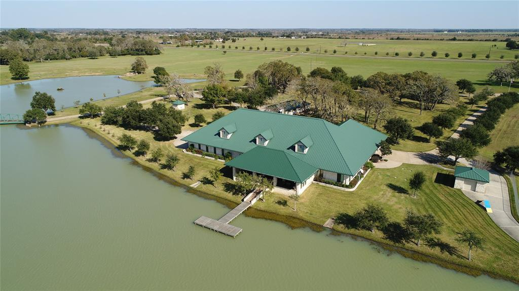 homes for sale in waller, high fence, lakes, fishing, exotics, ag exempt, family compound, horses, deer, dove,  | 23407 Fm 362 Road Waller, TX 77484 24