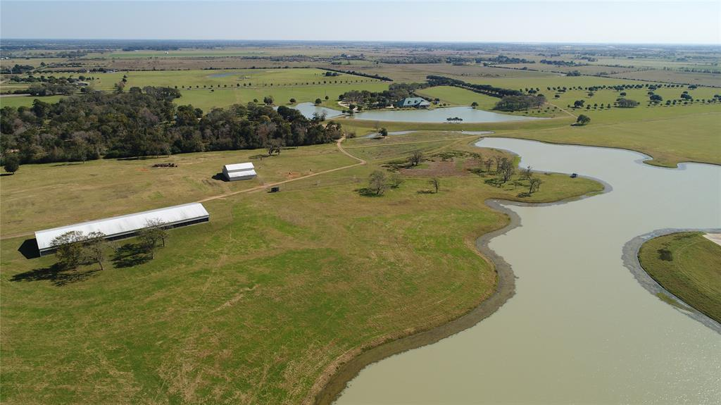 homes for sale in waller, high fence, lakes, fishing, exotics, ag exempt, family compound, horses, deer, dove,  | 23407 Fm 362 Road Waller, TX 77484 25
