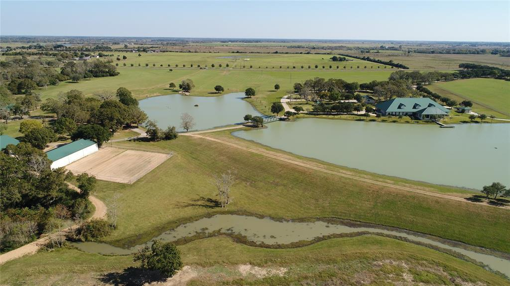 homes for sale in waller, high fence, lakes, fishing, exotics, ag exempt, family compound, horses, deer, dove,  | 23407 Fm 362 Road Waller, TX 77484 26