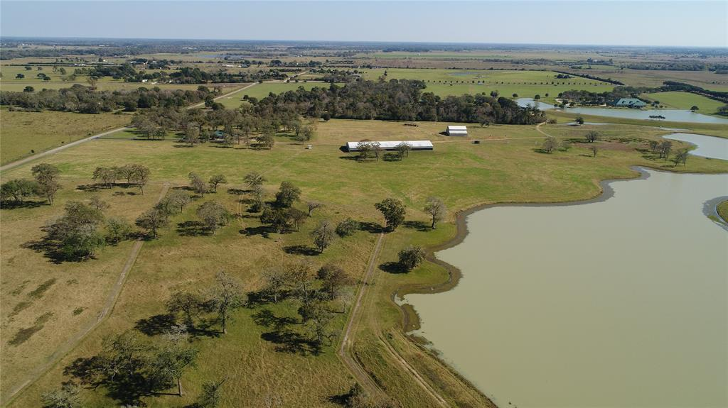 homes for sale in waller, high fence, lakes, fishing, exotics, ag exempt, family compound, horses, deer, dove,  | 23407 Fm 362 Road Waller, TX 77484 34