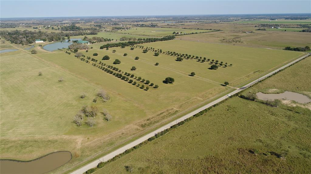 homes for sale in waller, high fence, lakes, fishing, exotics, ag exempt, family compound, horses, deer, dove,  | 23407 Fm 362 Road Waller, TX 77484 37