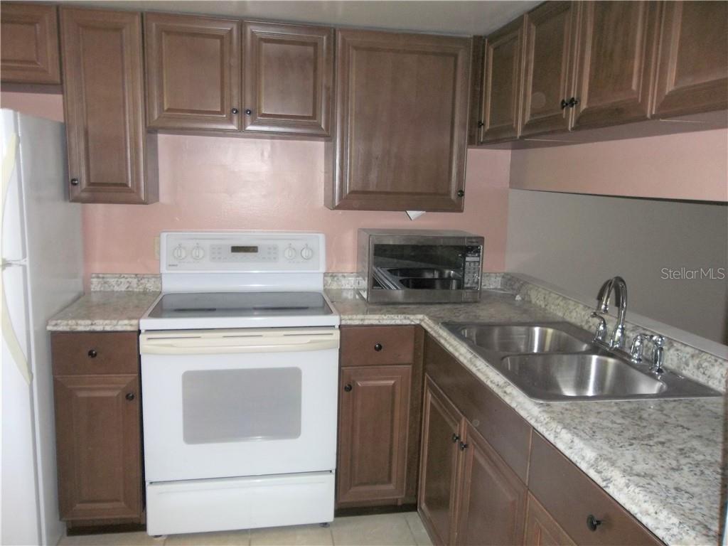 Sold Property | 5031 BORDEAUX VILLAGE  PLACE #201 TAMPA, FL 33617 5
